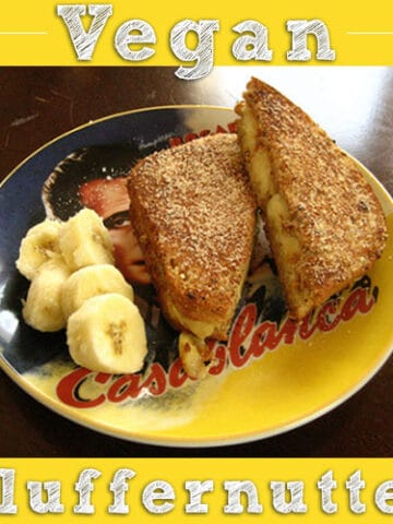 vegan fluffernutter sandwich on a Casablanca plate with sliced banana on the side