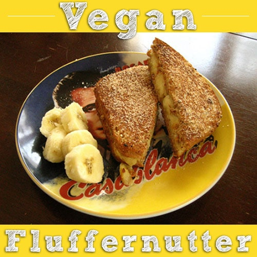 vegan fluffernutter sandwich on a Casablanca plate with sliced banana on the side