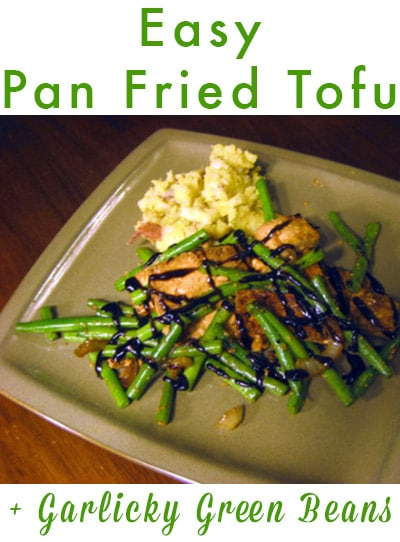 pan fried tofu with green beans on a plate with hoisin sauce on top