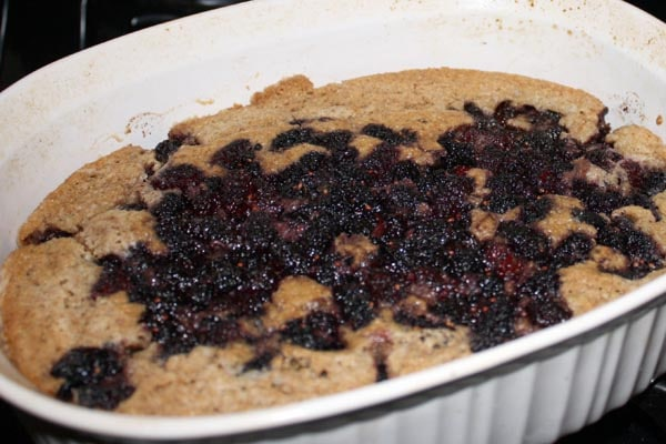 A buckle is sort of like cake-meets-pie in a messy and delicious way. You can use mulberries, blackberries, or any seasonal berries in this recipe.