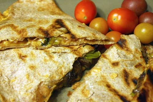 These vegan grilled quesadillas are deliciously dairy free and stuffed with sweet leeks and savory portobello mushrooms.