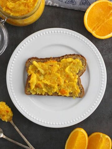 toast spread with orange marmalade