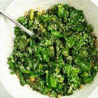 close-up of ginger-sesame kale stir fry in a serving bowl