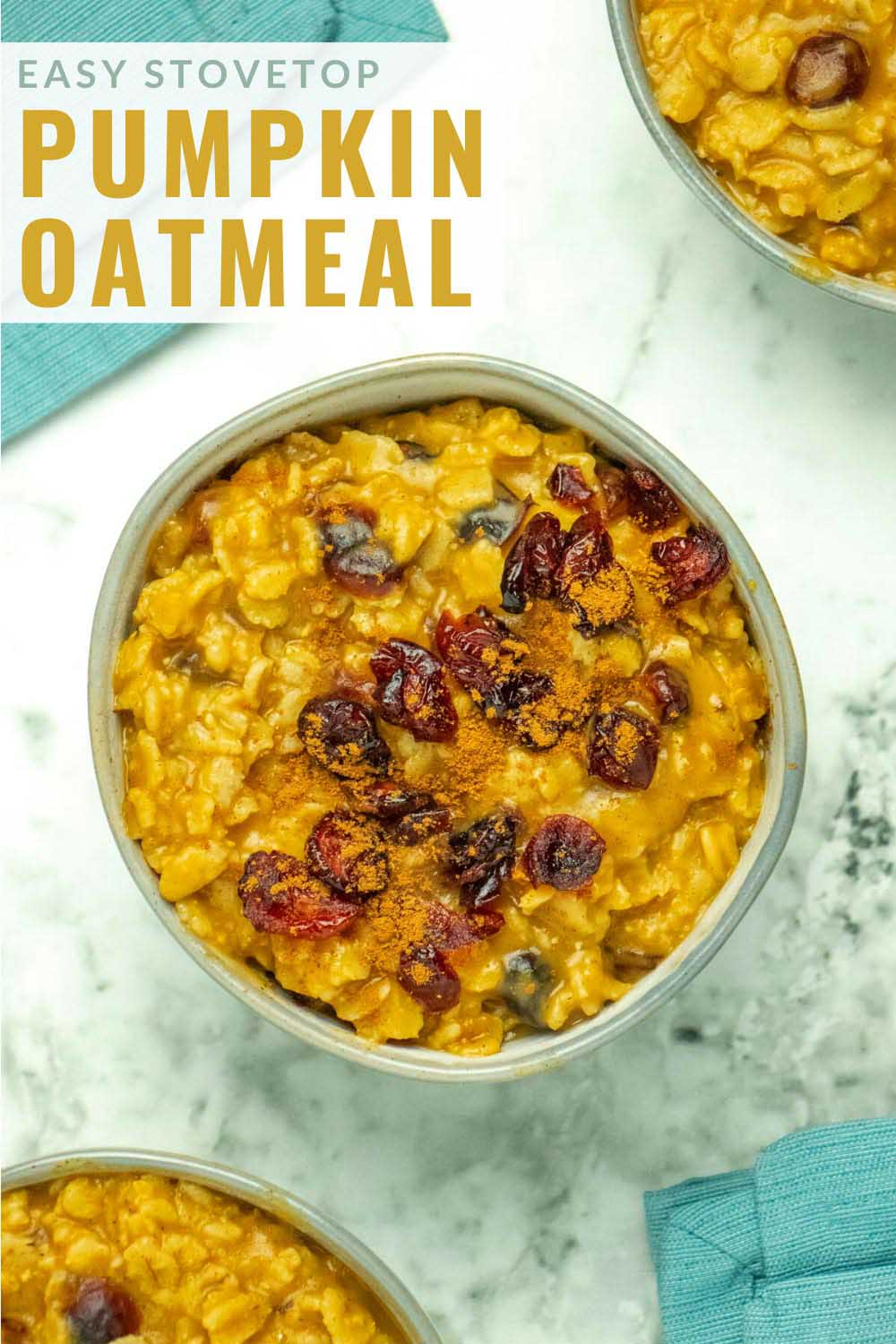 bowls of pumpkin oatmeal with cranberries and pumpkin spice, text overlay