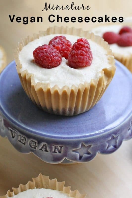 close-up of a mini vegan cheesecake topped with raspberries