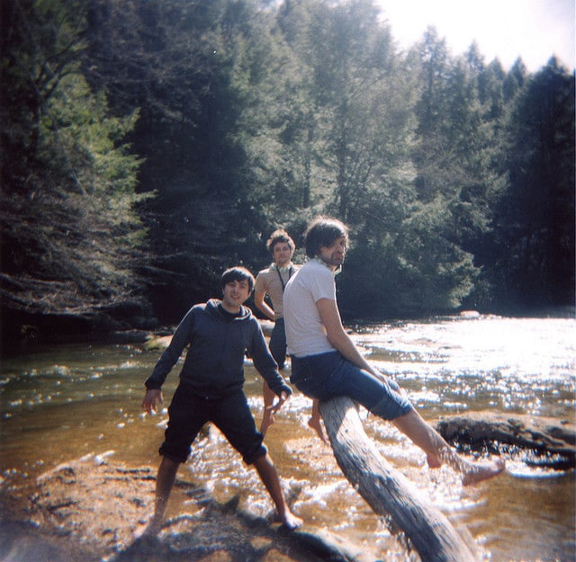 friends playing in a river