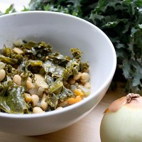 Rich kale soup with caramelized onions and white beans makes a perfect fall or winter supper!