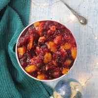 overhead photo of orange cranberry sauce on a table