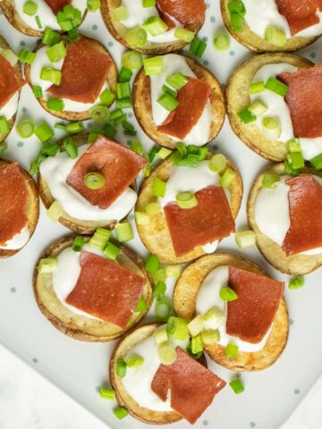 serving tray with mini baked potato appetizer
