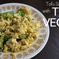 vintage plate on a wooden table with a vegan broccoli and tofu scramble
