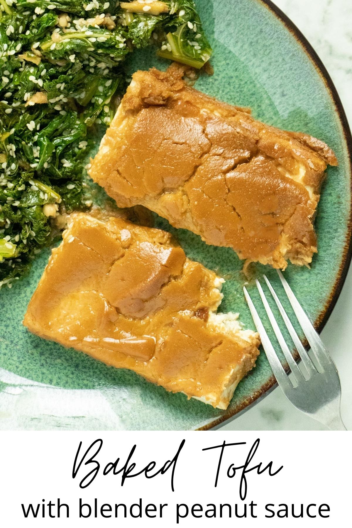overhead photo of baked tofu with peanut sauce on a plate with ginger kale, text overlay