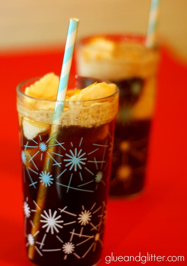 glasses of orange root beer floats on a table