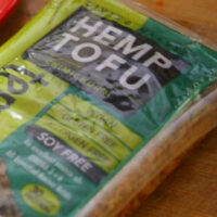 package of hemp tofu on a wooden countertop