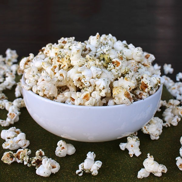 White bowl of popcorn tossed with homemade ranch seasoning