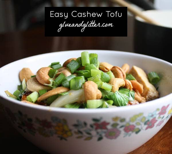 A bowl of cashew tofu, text overlay