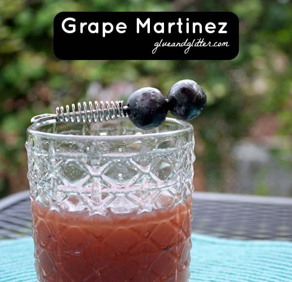 grape martinez in a glass with grape garnish, text overlay