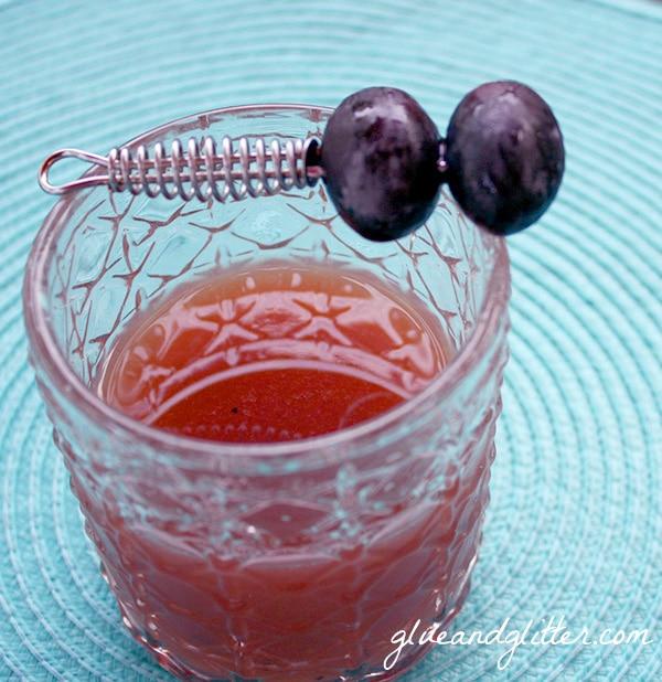 grape martinez in a glass with grape garnish