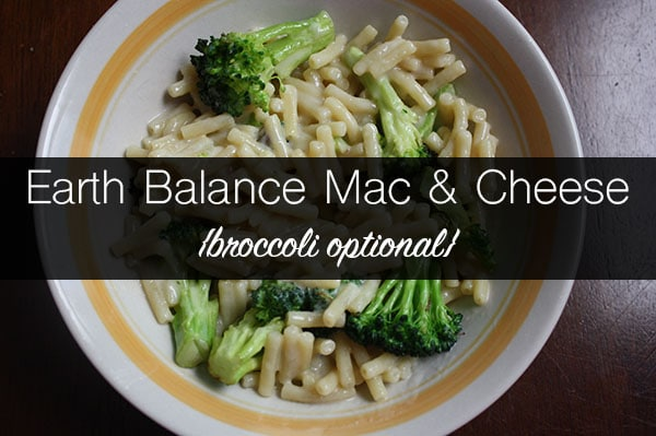 bowl of vegan mac and cheese with broccoli, text overlay