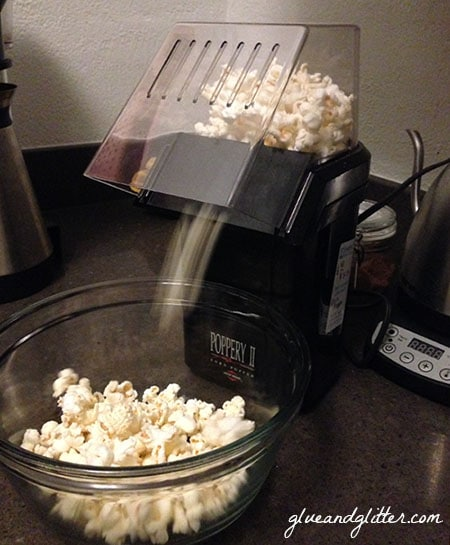 popcorn coming out of the air popper