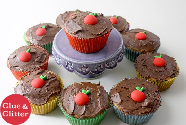 chocolate cherry cupcakes with cherry candy decoration on a white table