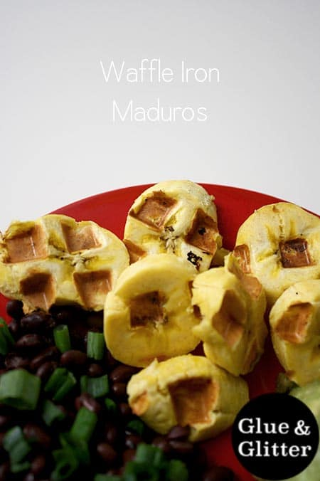 close-up of waffle iron maduros on a red plate with black beans and a text overlay