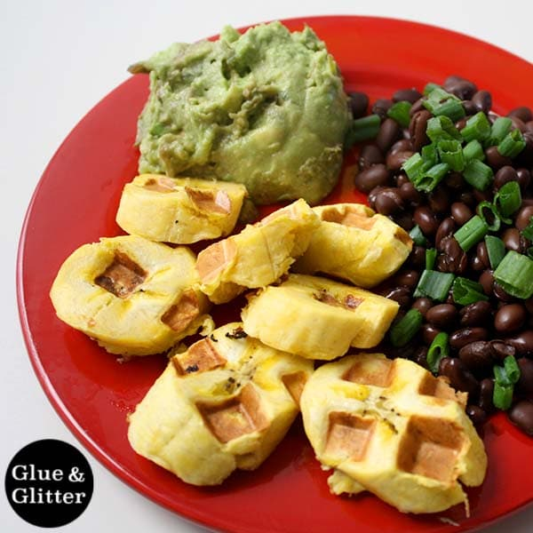 plate of waffle iron sweet plantains next to black beans and guacamole