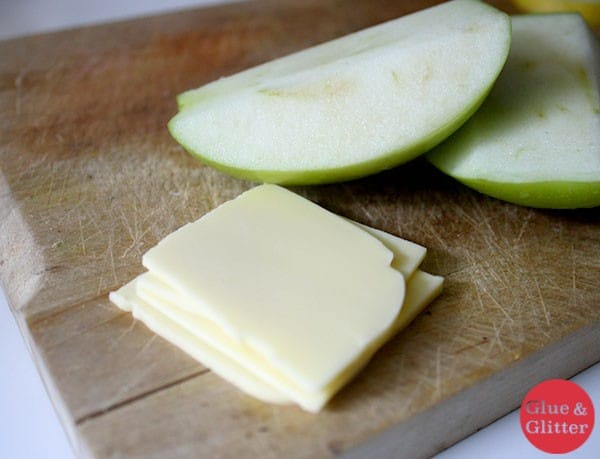 vegan cheese slices next to apple slices