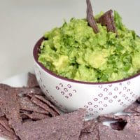 My 10 Minute Guacamole Recipe - This guacamole recipe takes 10 minutes to make, from chop to finish. My kid likes it so much that he often eats it with a fork as a side dish, skipping those pesky chips or tortillas.