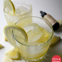 glasses of pineapple rum smash with ice and lemon wheel as garnish