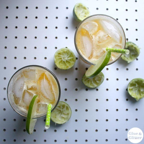 overhead photo of the shandy in pint glasses with limes on the table