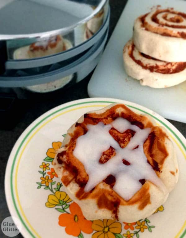 Sometimes you just have to put cinnamon rolls into the waffle iron. Cinnamon roll waffles are crispy on the outside, soft on the inside, and so, so easy to make.