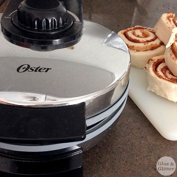 Sometimes you just have to put cinnamon rolls into the waffle iron. Waffle iron cinnamon rolls are crispy on the outside, soft on the inside, and so, so easy to make.