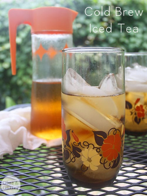 cold brew iced tea on a patio table with a pitcher behind it