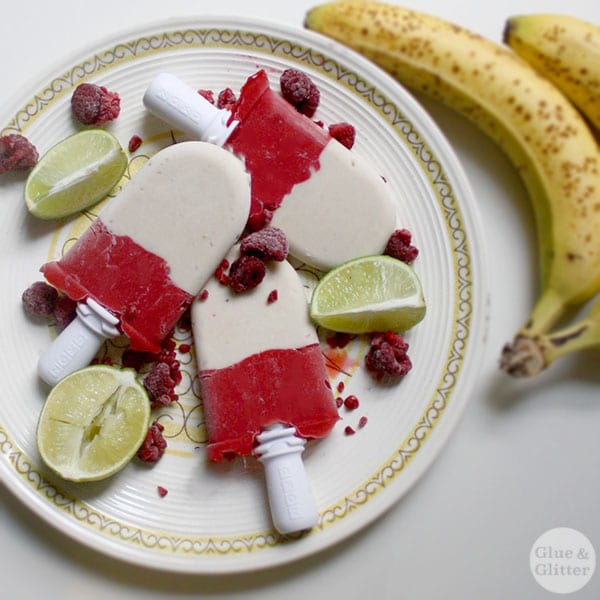 These layered raspberry and banana pops are my son's two favorite treats, mashed up into one.