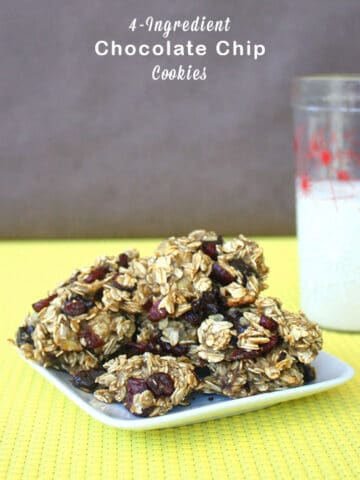 plate of cookies on a yellow table next to a glass of vegan milk, text overlay