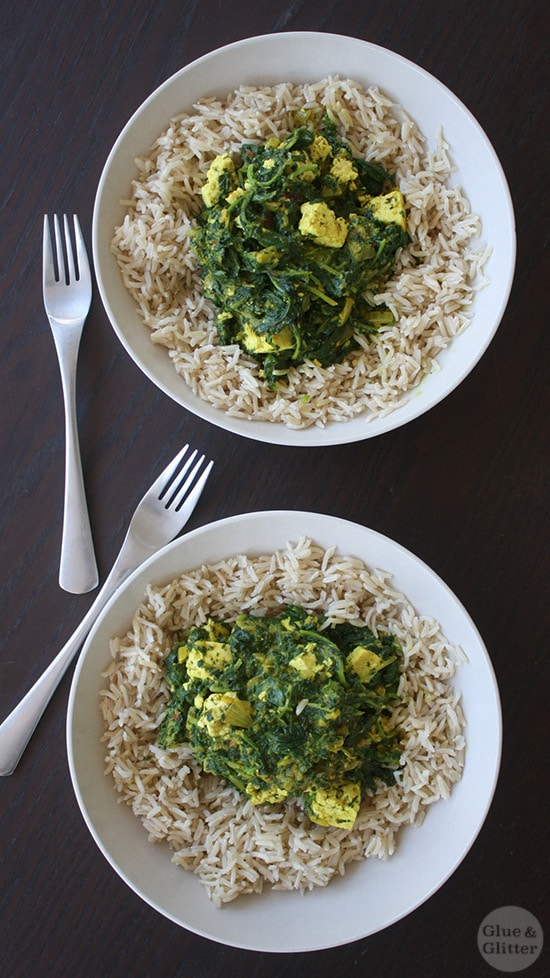 Two bowls of saag tofu on a wooden tabletop