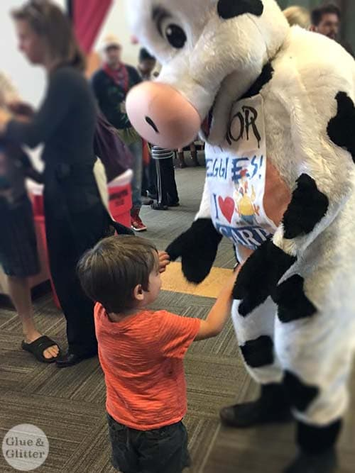 A boy and his cow friend at Atlanta Veg Fest!