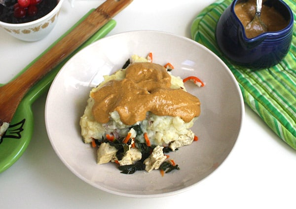Braised tofu and greens topped with mashed potatoes and plenty of gravy. It's a vegan Thanksgiving meal in one pot!