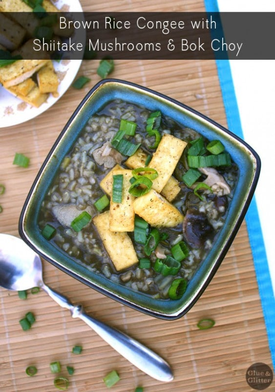 overhead photo of brown rice congee with mushrooms, tofu, and green onions next to a small plate of baked tofu, text overlay