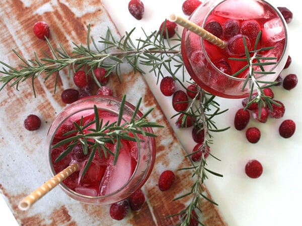 Sweet-and-spicy ginger syrup plus tart cranberry juice and bubbles. You can serve this ginger cranberry fizz with our without a splash of booze.
