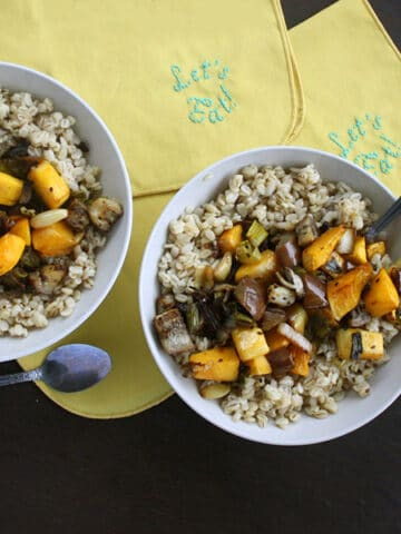 bowls of barley topped with roasted vegetables