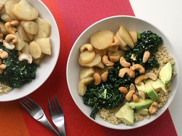Sweet parsnips, creamy avocado, gingered kale, and cashews in a nutty quinoa buddha bowl!