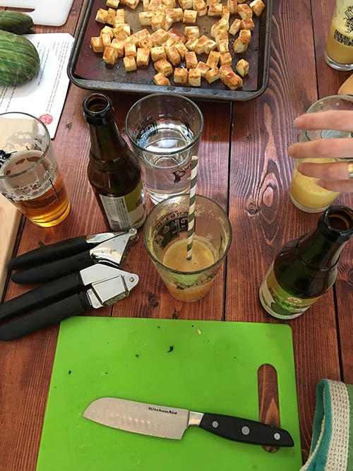 glasses of beer and cocktails on a wooden table