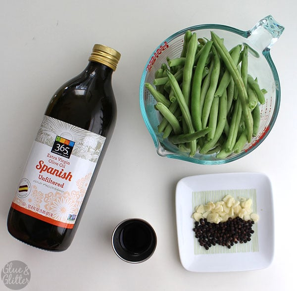 frizzled green beans almondine ingredients on a white tabletop