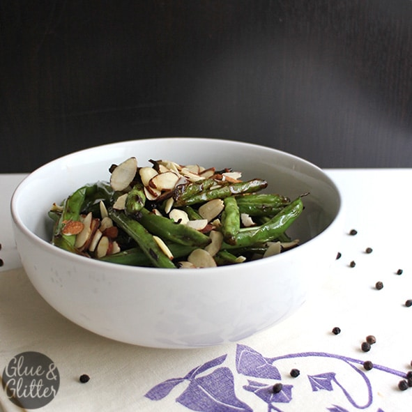 Frizzled green beans almondine is a simple, 6-ingredient side dish that takes around 10 minutes to make.