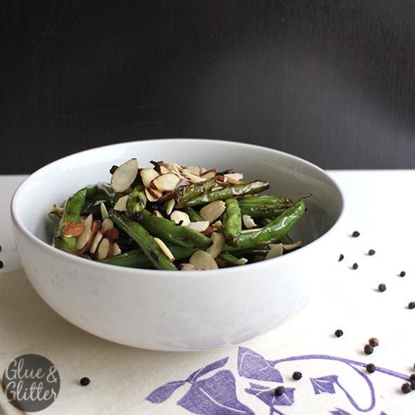 white bowl of green beans almondine