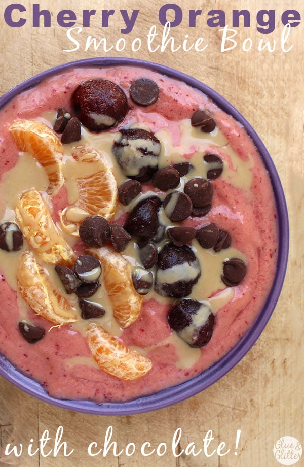 A cherry orange smoothie bowl drizzled with tahini and sprinkled with chocolate chips. Don't mind if I do!