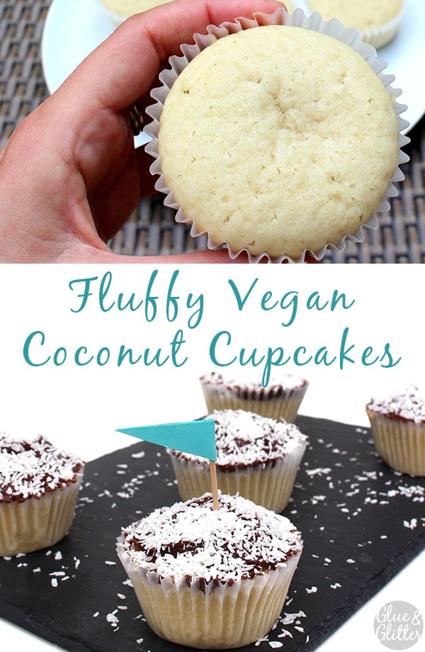 serving tray of vegan coconut cupcakes with chocolate frosting and shredded coconut on top. One cupcake has a tiny blue flag in it, text overlay