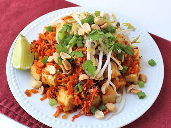 Orange Tofu in a sweet, flavorful sauce with sticky sweet potato noodles. A healthier, vegan spin on a favorite Chinese take-out dish!