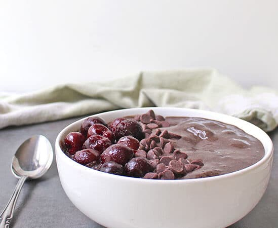 A chocolate covered cherry smoothie bowl packed with chocolate, cherries and some sneaky greens and protein. Breakfast is served!